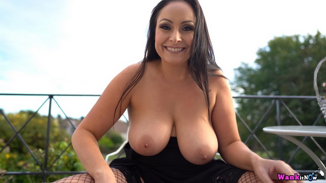 Bigtitted UK brunette Sophia Delane spreads fishnet clad legs for outdoor wank