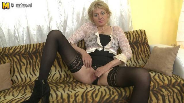 Heated housewife opens her stocking-clad and booted legs eager to get in touch with her inner self