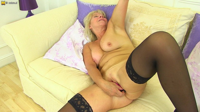 Elegant mature lady Emily Jane wears black holdups & high heels for a solo show