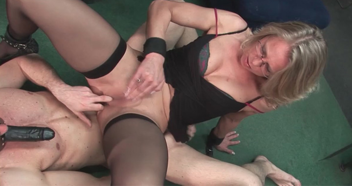Kinky German chicks in black stockings blowing and riding dildo-faced male subs