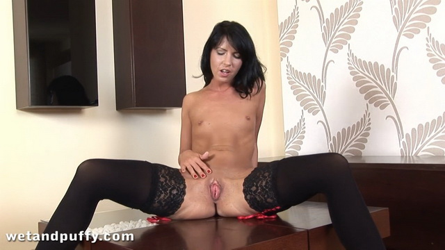 Dark-haired Jane wiggles her thong-clad ass and fucks a mean toy in sexy opaques