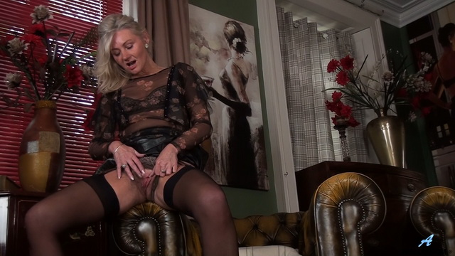 Aging English lady Ellen B. spreads her slim stocking-clad legs to finger fuck her wet hairy snatch