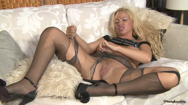 Curvaceous blonde nylon kinkster Taylor Morgan tears to shreds her fine pantyhose