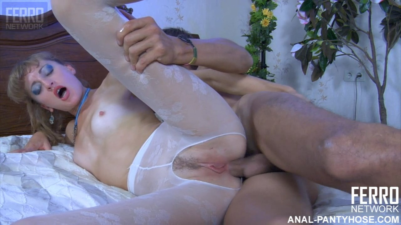 Leggy chick in white flowery tights gets a back massage before backdoor fun