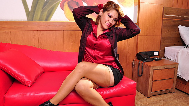 Stacked Latina mommy Andrea M. clad in red silk, black panty-n-bra set and tan nylons starts rubbing her clit