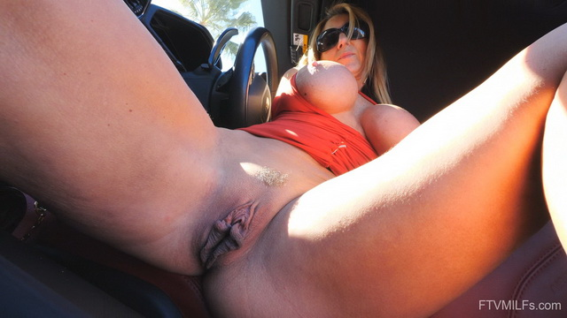 Super-busty thong-clad milf Ainslee Divine pulls up her red dress for car spreads