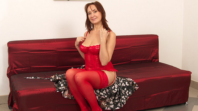 Naughty unshaved housewife Lucy in red lingerie and stockings playing with herself