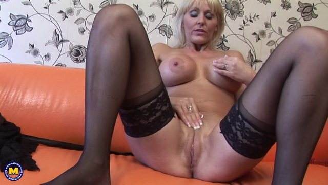 Busty UK mature Jan Burton peels her luxury lingerie and dildo toys in stockings