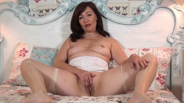 Horny UK mature Kitty Cream spreads legs in her vintage lingerie and stockings