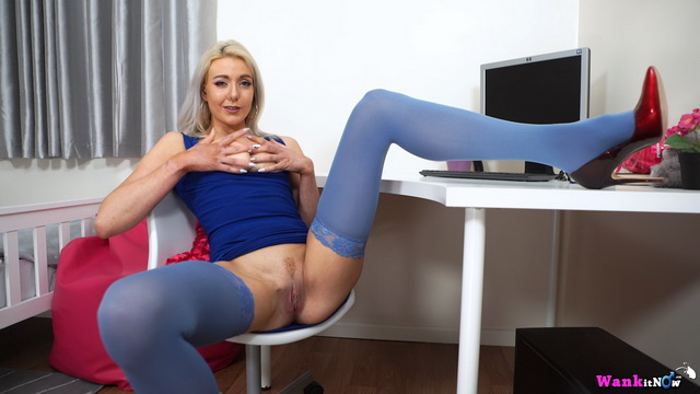 Platinum blonde Sapphire Blue opens legs in blue opaques for a toy and good wank