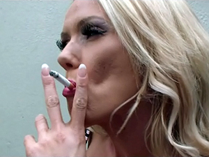 British blonde bombshell Lucy Zara smokes a cig before masturbation in stockings