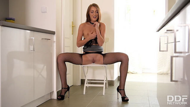Katy Rose parts endless legs in net suspender hose getting dirty in the kitchen