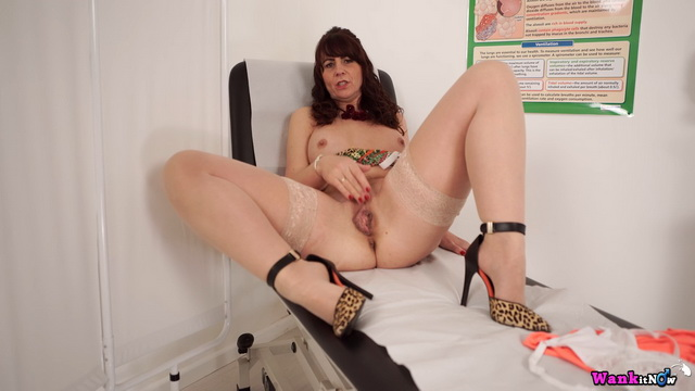 Mature Toni Lace shows white lace lingerie and parts stockinged legs for a wank