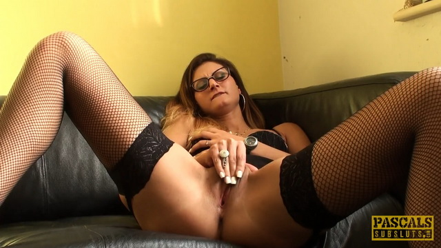 Eva Johnson masturbates in black fishnet stockings