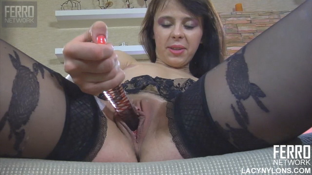 Pretty brunette Margarita A. in fashion nylons with a lush garter belt uses a glass toy