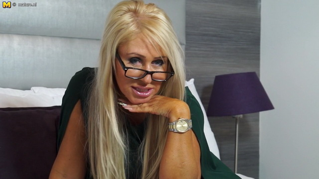 Hot British MILF Miss Makepeace playing with her wet pussy