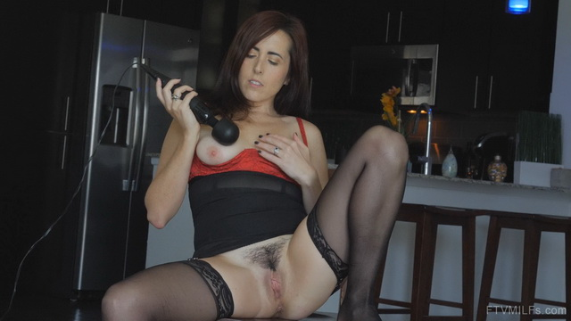 Black-stockinged milf Dixie Comet uses a magic wand on her tits and soaking slit