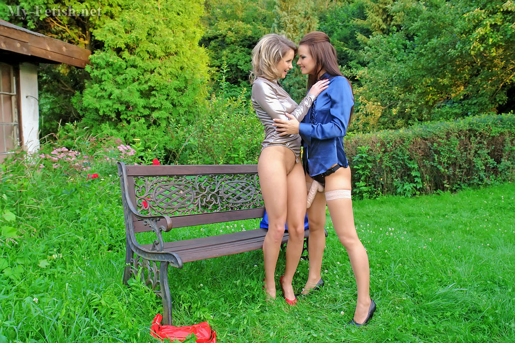 Clad in silk and nylon lesbians having raw strapon sex outdoors