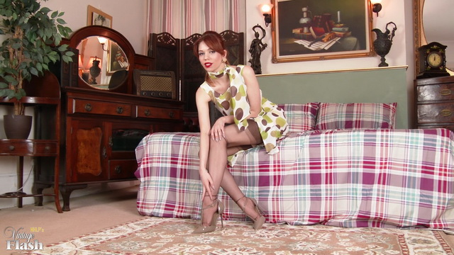 British redheaded minx Poppy Spink gets from elegant to naughty in vintage fully-fashion stockings