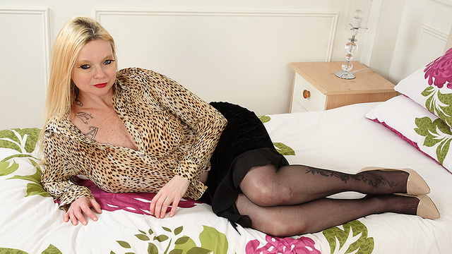 Black-stockinged UK mature Summer Angel Lee bares her giant rack, licks wet panties and uses a toy