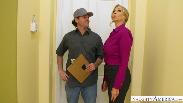 Big-breasted pornstar Julia Ann dons her lacy bra, garters and fishnets to pay a service guy in kind