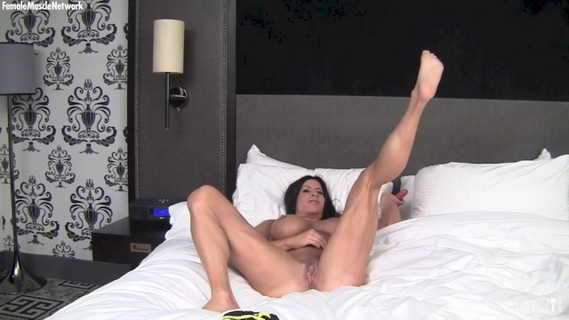 Female bodybuilder Angela Salvagno with big tits and a big clit uses a fuck toy