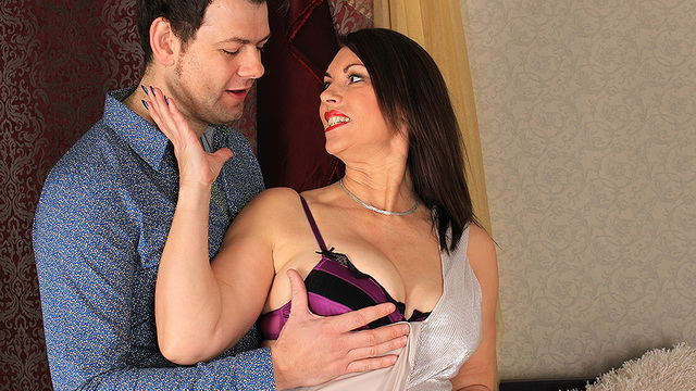 Busty English milf Christine O. gets laid in her silver evening gown, purple lingerie and stockings