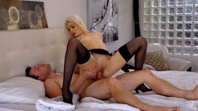 Gorgeous blonde Elsa Jean hops on a boner in her classy black gartered stockings