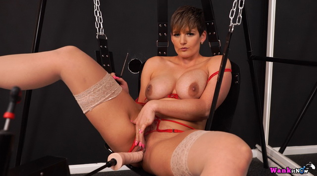 English milf Hannah Brooks tests a fuck-machine on a swing parting nyloned legs