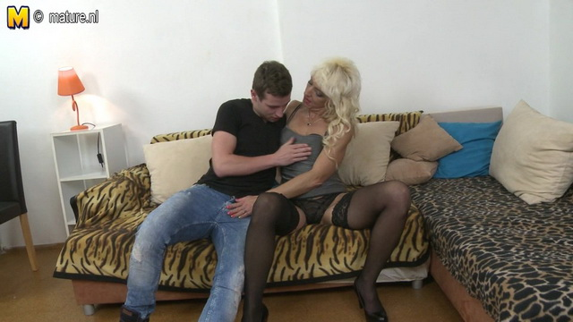 Lewd blonde housewife in black lace top holdups stuffs cock into her hungry mouth and raging pussy