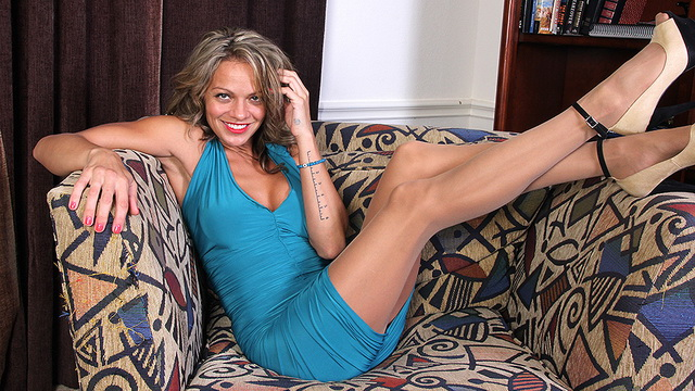 Naughty American MILF CJ playing with herself on the couch
