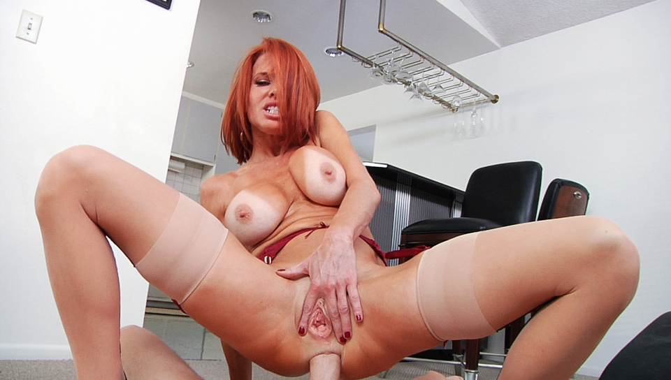 Red-headed Veronica Avluv in barely there stockings getting anal in the kitchen
